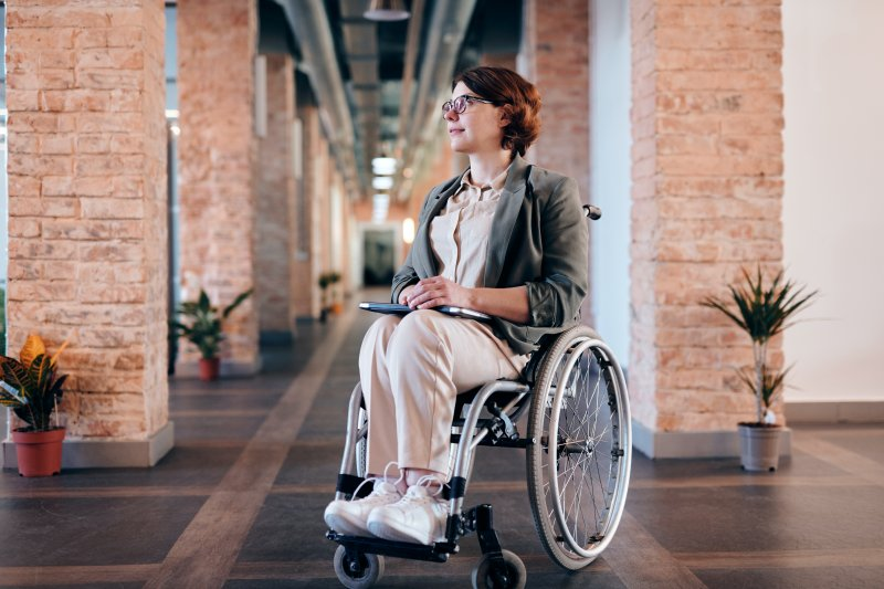 woman-in-gray-coat-sitting-on-wheelchair-4064335